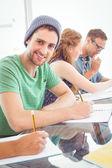 Fashion students writing on notepad  — Φωτογραφία Αρχείου