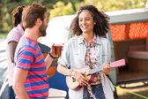 Happy hipster at their festival campsite — Stock Photo