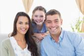 Happy parents with daughter at home — Stock Photo