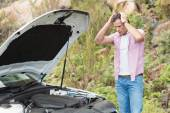 Stressed man looking at engine — Stock Photo