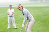 Lady golfer watched by partner — Stock Photo