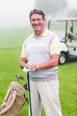 Golfer smiling at camera — Stock Photo