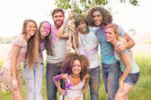 Happy friends covered in powder paint — Stockfoto