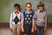 Smiling little school kids in classroom — Stock Photo