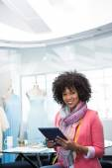 Female fashion designer using digital tablet — Stock Photo