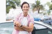 Man smiling and holding key — Stock Photo