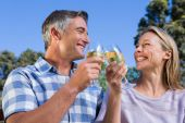 Couple relaxing in the park with wine — Stock Photo