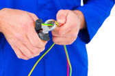 Electrician cutting wire with pliers — Stock Photo