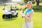 Golfer standing on the putting green — Stock Photo