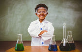 Cute boy with conical flasks in classroom — Stock Photo