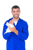 Male mechanic wiping hands with cloth — Stock Photo