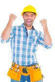 Excited manual worker clenching fists — Stock Photo