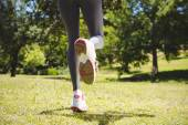 Fit woman taking a step — Stock Photo