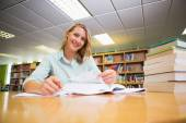 Pretty student studying in the library — Stock Photo