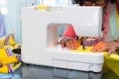 Fashion designer using sewing machine — Stock Photo