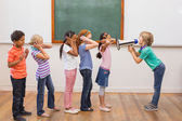 Cute pupil shouting in classroom — Stock Photo