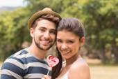 Cute couple sharing a lollipop — Stockfoto