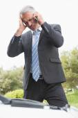 Desperate man calling for assistance after breaking down — Stock Photo