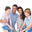 Children sitting on parents laps over white background — Stock Photo #68981469