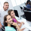 Computer teacher and pretty female students — Stockfoto #68981513