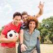 Happy friends in the park with football — Stock Photo #68981573