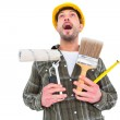 Screaming manual worker holding various tools — Stock Photo #68982403