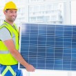 Manual worker carrying solar panel at office — Stock Photo #68982755