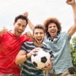 Happy friends in the park with football — Stock Photo #68983129