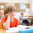 Concentrate pupils sitting at his desk — Stock Photo #68983193