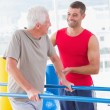 Senior man walking with coach help  — Stock Photo #68983469