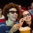Young friends watching a 3d film — Stock Photo #68983507