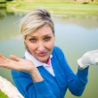 Worried female golfer looking for golf ball — Stock Photo #68984195