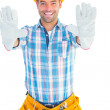 Happy manual worker making stop sign — Stock Photo #68984291