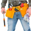 Manual worker holding gloves and hammer — Stock Photo #68985603