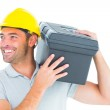 Handyman carrying toolbox on shoulder — Stock Photo #68986013