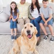 Smiling family with Golden Retriever — Stock Photo #68986389