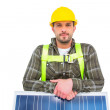 Manual worker with solar panel — Stock Photo #68987891