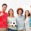 Happy friends in the park with football — Stock Photo #68988311