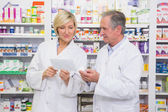 Pharmacists team interacting about prescription — Stock Photo