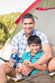 Father and son beside tent — Stock Photo