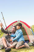 Father and son by their tent — Foto de Stock