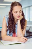 Fashion student taking notes in class — Stock Photo