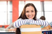 Smiling female student in classroom — Stock Photo
