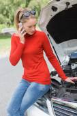 Young woman looking at engine — Stock Photo