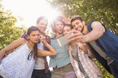 Happy friends in the park taking selfie — Stock Photo