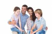 Children sitting on parents laps over white background — Stock Photo