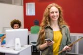 Businesswoman text messaging in office — Stock Photo