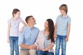 Family smiling while looking at each other — Stock Photo