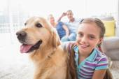 Girl with dog while parents relaxing — Stock Photo