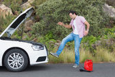 Angry man after car breakdown — Stock Photo